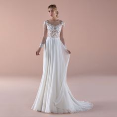 Enchanting sheath ivory dress in chiffon and enriched by beaded applications. For a woman who wants to amaze everybody with simplicity. Ivory Dresses, Prom Dresses, Formal Dresses, Wedding Dresses, Nicole Fashion, Fashion Group, Chiffon Skirt, Bridal Collection, Couture
