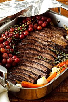 Try an old favorite a new way. Wine replaces the traditional water and tomato sauce braising liquid in this delicious beef brisket recipe while grapes and herbs join the carrot and onion mixture. #hanukkah #hanukkahrecipes #hanukkahfood #traditionalrecipes #dinner #bhg All You Need Is, Brisket Seasoning, Beef Brisket Recipes, Hanukkah Food, Roasted Carrots, Pot Roast, Fresh Fruit, Holiday Recipes, Ethnic Recipes