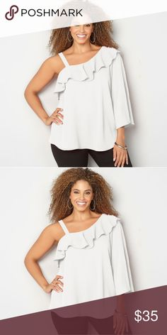 Gorgeous white one shoulder top sz 18/20 With a feminine ruffle and all over crepe texture with a 3/4 in sleeve complete this beautiful top poly machine wash Avenue Tops Blouses