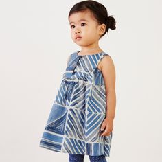 Commander's Diamond Baby Dress | This geometric pattern is inspired by Italian artist Gio Ponti's painted tile work in the Parco Hotel dei Principi in Almalfi. Ponti was given the title of Commander of the Royal Order of Vasa in Stockholm in 1934. Matching bloomers are included up to size 24 months.
