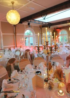 A Romantic banqueting lay out, round tables generally allow greater social interaction as everyone at the table can see and talk to everyone else at the table.