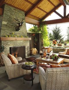 Outdoor living in Portland with crucial fireplace. Garrison Hullinger Interior Design.