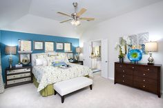Gehan Homes - Master Bedroom Austin, Texas   Meadows at Buda - Mahogany Teal and green, sea glass, modern, pop of blue, white orchid, contrast, use of color, small windows, contemporary bedding, pillows, artwork #Gehanhomes
