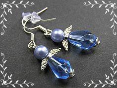 UNIKAT  Ohrhänger aus hellblauen Tropfen-Glasperlen, hellblauen Glaswachsperlen, silbernen Perlenkappen sowie kleinen, filigranen silberfarbigen Engelsflügeln.  Länge incl. Ohrhaken...