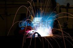 Arc Welding In Manufacturing Plant With Flying Sparks Stock Photo, Picture And Royalty Free Image. Image 8147280.