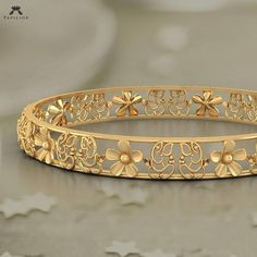 faithful ganesha floret bangle buy gold bangle online in india Gold Ring Designs, Gold Bangles Design, Gold Jewellery Design, Gold Jewelry, Jewelry Necklaces, Fine Jewelry, Diamond Bracelets, Handmade Jewellery, Silver Bracelets