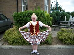 Aboyne with rust vest and gold trim #young #burgundy #tartan