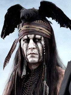 """Depp drew from a painting by artist Kirby Sattler titled """"I Am Crow."""" """"The whole reason I wanted to play Tonto is to try to [mess] around with the stereotype of the American Indian,"""" he said. """"That makeup inspired me … It just so happened Sattler had painted a bird flying directly behind the warrior's head. I thought: Tonto's got a bird on his head. It's his spirit guide in a way. It's dead to others, but it's not dead to him. It's very much alive."""""""