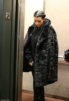Chic: The 34-year-old wore a fuzzy coat over a black hooded sweatshirt...
