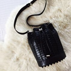 """Alexander Wang Alpha Bucket Bag •Drawstring bucket bag with metallic toggle and connector. Signature rhodium dogclip and studded rhodium button. Nylon lined interior has phone pocket and zip pocket. 100% Bovine  •Measures: 9""""L x 10""""H x 9""""W with a 21"""" shoulder strap drop  •Dust bag and authenticity card included.  •New with tag (but on display so very light marks on exterior, barely noticeable). NO TRADES/PAYPAL/LOWBALL OFFERS. Alexander Wang Bags"""