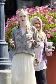 Elle Fanning shows off her fashion sense in a white maxi skirt, a camo print shirt, Persol sunglasses and a Valentino studded bag, as she has a cup of Starbucks coffee. What were you doing when you were 15?! Together with her older sister, Dakota Fanning,