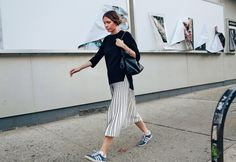 With a Loewe bag and in Adidas shoes