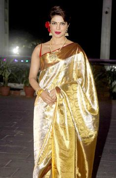 Priyanka Chopra in a cream and gold kanjivaram saree