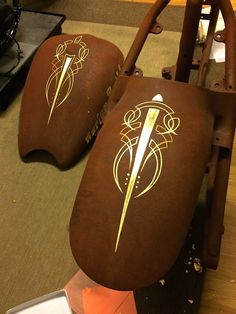 Gold leafed chopper gas tank and fender.. With outline and pinstriping