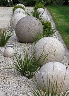 These cool and unique DIY Garden Globes are a bold statement for the modern garden room but can be softened with pretty intertwining flowers. Next Previous Cool and Unique DIY Garden Globes Dream Garden, Garden Art, Terrace Garden, Rocks Garden, Pebble Garden, Cement Garden, Courtyard Gardens, Cement Planters, Gravel Garden