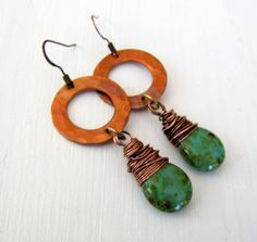 Boho Hammered Copper Earrings Hammered copper rings/hoops have been slightly oxidized to give them a warm patina. Ive wirewrapped green Picasso finished, Czech glass briolettes in copper wire which I have also given a well worn patina. The earrings come on copper earwires and measure about 2.5 inches long. These earrings are suitable for both work and play. To see my other earrings click here https://www.etsy.com/shop/TwigsAndLace?section_id=12058171&ref&#x...
