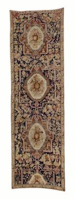 KARABAGH GALLERY CARPET  SOUTH CAUCASUS, LATE 19TH CENTURY  Approximately 22 ft. 4 in. x 6 ft. 8 in. (681 cm. x 234 cm.)