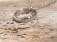 Silver plated Lord of the rings necklace - with 'the one' ring - elvish engraved. $12.95, via Etsy.