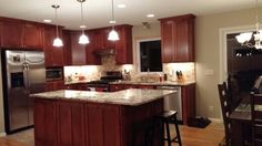 Split entry kitchen remodel - we removed walls and pushed the header into the attic to create an open floor plan. We love how it turned out!