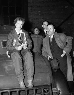 Amelia Earhart, with her husband, George Putnam, after completing her nonstop flight from Mexico City, a 2,100-mile journey, in 14 hours and 20 minutes, May 8, 1935, Newark, N.J.