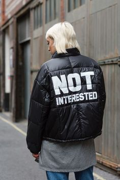 Go tough in this shiny puffer jacket with 'No Guts, No Glory' slogan to the front and 'Not Interested' wording to the back. In an oversized fit, the jacket also features anthracite trims. #Topshop: