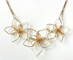 Wire Flower Necklace · How To Make A Wire Pendant · Jewelry on Cut Out + Keep Diamond Bar Necklace, Triangle Necklace, Wire Necklace, Flower Necklace, Flower Jewelry, How To Make Necklaces, Unique Necklaces, Wire Pendant, Pendant Jewelry