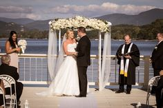 Gorgeous ceremony on the dock at The Ridges Resort. Wedding venue is amazing if you want a lake or mountain wedding.