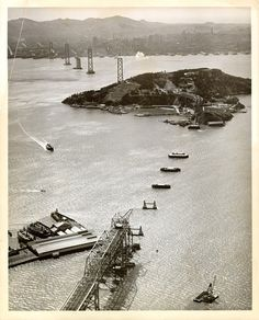 Aerial view looking west toward San Francisco showing towers, anchorage, and Yerba Buena Island span being erected for San Francisco-Oakland Bay Bridge California History, Vintage California, San Francisco City, San Francisco California, Old Pictures, Aerial View, Golden Gate Bridge, Historical Photos, Tower