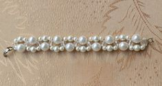 Free pattern for beaded bracelet Clarity   U need: pearls 10 mm, pearls 6mm pearls 4 mm faceted round beads 6 mm seed beads 11/0   Start with 2 needles