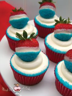 Bird on a Cake:  Red, White and Blue Strawberry Cupcakes - strawberry cupcakes with cream cheese frosting; strawberries dipped in white chocolate and then blue sanding sugar.