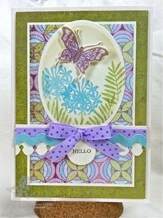 A hand-made greeting card created with care and attention to detail; using top quality papers, ink, ribbon and hand made embellishments and