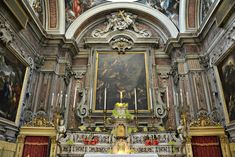 """Santa Maria Egiziaca a Forcella, Naples.  The elaborate main altar by Gennaro Rogozzino was completed in 1713, and hosts an altarpiece depicting """"First communion of Santa Maria Egiziaca"""" (1696) by Andrea Vaccaro."""