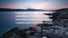 "Amy Bloom Quote: ""Love at first sight is easy to understand; it's when two people have been looking at each other for a lifetime that it becomes a miracle."""