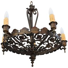 Beautiful 1920's Spanish Revival Chandelier.  SOLD.  This one is sold, but we have hundreds of 1920s chandeliers available on our website....http://revivalantiques.com/antique-chandeliers-ycy-6.html