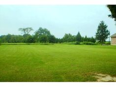 adjoining 1/2 acre lot