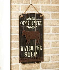 Add some rustic charm and a touch of humor to your home with a Wooden Country Sign. Hanging on your covered porch or in your kitchen, the witty saying is s