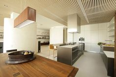 Apartment: Impressive Apartment Design in Saint Petersburg by MK-Interio, Clean Kitchen of Saint Petersburg Apartment Designed by MK-Interio with Wooden Dining Set and Pendant Lamp and Wood Ceiling Planks also Modern Cabinetry