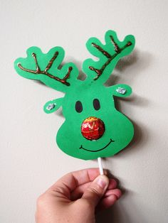 Lollipop Nose Reindeer: fold card in half, open with crease on top, trace reindeer outline with chin finishing on fold mark; make a small hole for the lollipop stick and a larger hole for the nose; refold and cut leaving chin attached at fold, decorate, insert lollipop! Cute!
