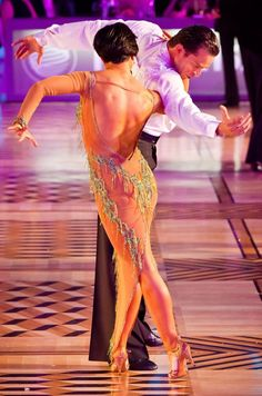Andrej Skufca and Melinda Torokgyorgy, 2012. Visit http://ballroomguide.com/workshop/latin.html for info about Latin workshops from the pros.