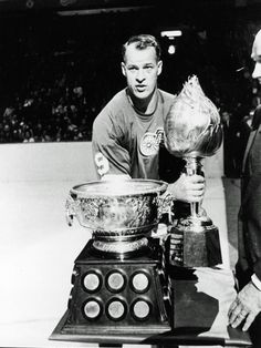 Gordie Howe of the Detroit Red Wings poses on the ice with the Art Ross and Hart trophies, The Art Ross Trophy is to the top NHL point earner in a season, while the Hart Trophy is given to the. Get premium, high resolution news photos at Getty Images Detroit Hockey, Detroit Sports, Detroit Lions, Hockey Goalie, Hockey Teams, Ice Hockey, Sports Teams, Hockey Trophies, Boston Bruins Goalies