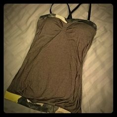 Lululemon padded workout tank Snazzy workout tank from lululemon. Back straps can be removed and adjusted, as shown. Padded with removable pad inserts. Signature logo on back. Cut off the tags because they were itchy. Size S. lululemon athletica Tops Tank Tops