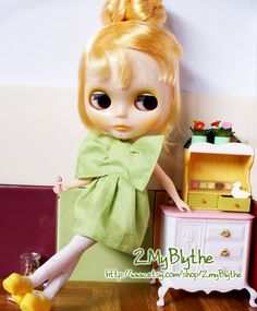 This little Blythe doll not only has a rocking outfit, she is way too cool for school.