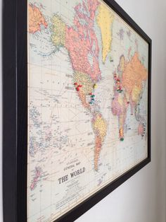 World magnetic travel map with antique white frame travel maps vintage map of the world with pins of where we have been gumiabroncs Images