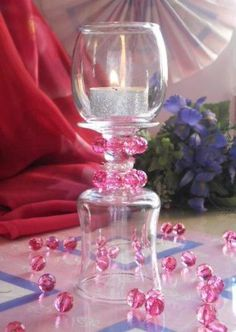 Centerpiece Ideas~Votive and wineglass tealight holder with pink and pearl bead decorations.~For more wine glass transformation ideas click pic!