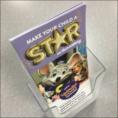 Here guests can grab detailed takeaway information from this convenient self-standing Chuck E Cheese Birthday Party Brochure Holder. Birthday Flyer, Birthday Parties, Chuck E Cheese Birthday, Spy Store, Brochure Holders, Cheese Party, March 3rd, Your Child, Literature