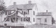 Inn with bunting on Main street.