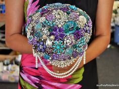 Cascading Brooch Bouquet in the Bride's colors:) #wedding #bouquet #cascading