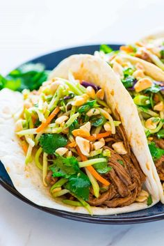 Melt-in-your-mouth Slow Cooker Asian Pulled Pork Tacos. EASY, delicious pork tenderloin tacos that are perfect for a crowd and great leftover too!