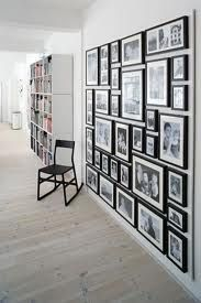 white wall, lots of black frames for a photo frame wall