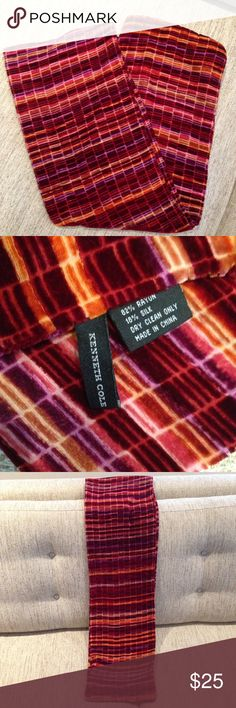 """20% off! Closet closing! Super Soft Velvet Scarf A beautiful scarf by Kenneth Cole with a soft velvety feel, in a palette of colors reminiscent of a gorgeous sunset sky in shades of crimson, orange and burgundy. Measures 58 """"x 8"""" Made of 82% rayon and 18% silk. Gently used & in excellent condition. Please comment for a 20% discount on this & other items. Closet closing November 1st. Kenneth Cole Accessories Scarves & Wraps"""